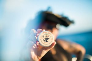 pirate holding tin